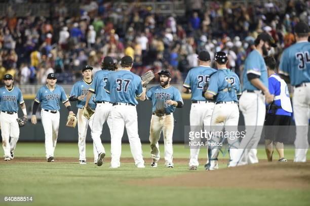 Coastal Carolina University celebrates their win over the University of Arizona during the Division I Men's Baseball Championship held at TD...