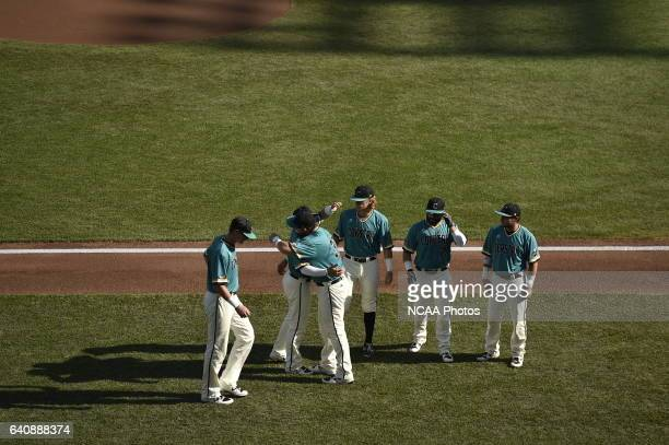Coastal Carolina University players are introduced before the start of the Division I Men's Baseball Championship against University of Arizona held...