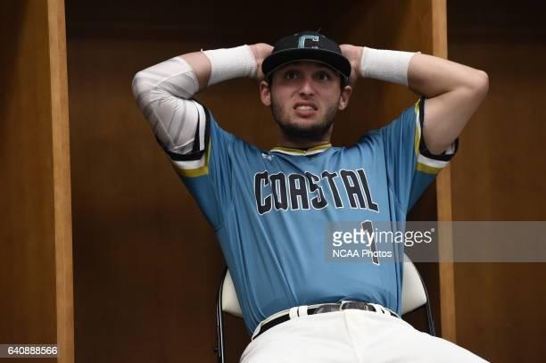 Coastal Carolina University players prepare before taking on University of Arizona during the Division I Men's Baseball Championship held at TD...