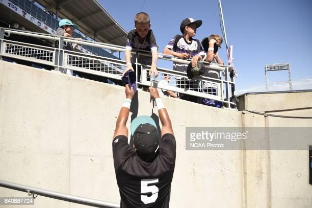 Coastal Carolina University players sign autographs for fans before taking on University of Arizona during the Division I Men's Baseball Championship...