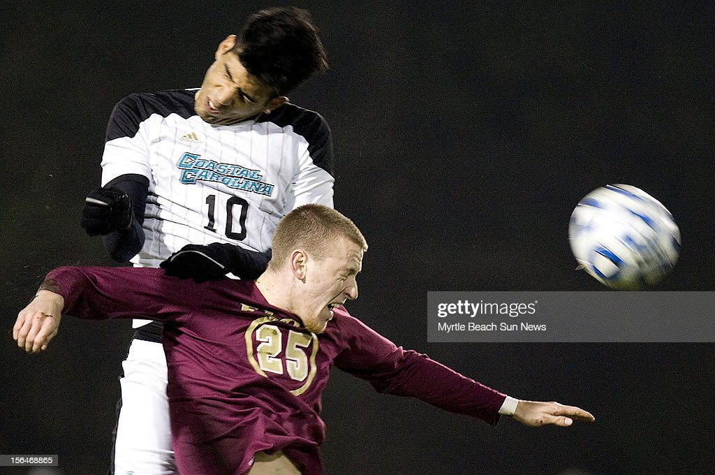 Coastal Carolina University's Pedro Ribeiro (10) and Elon's Jason Waterman (25) go for a head ball during a first-round match in the NCAA Men's Soccer Championship in Conway, South Carolina, Thursday, November 15, 2012. Coastal defeated Elon, 3-0.