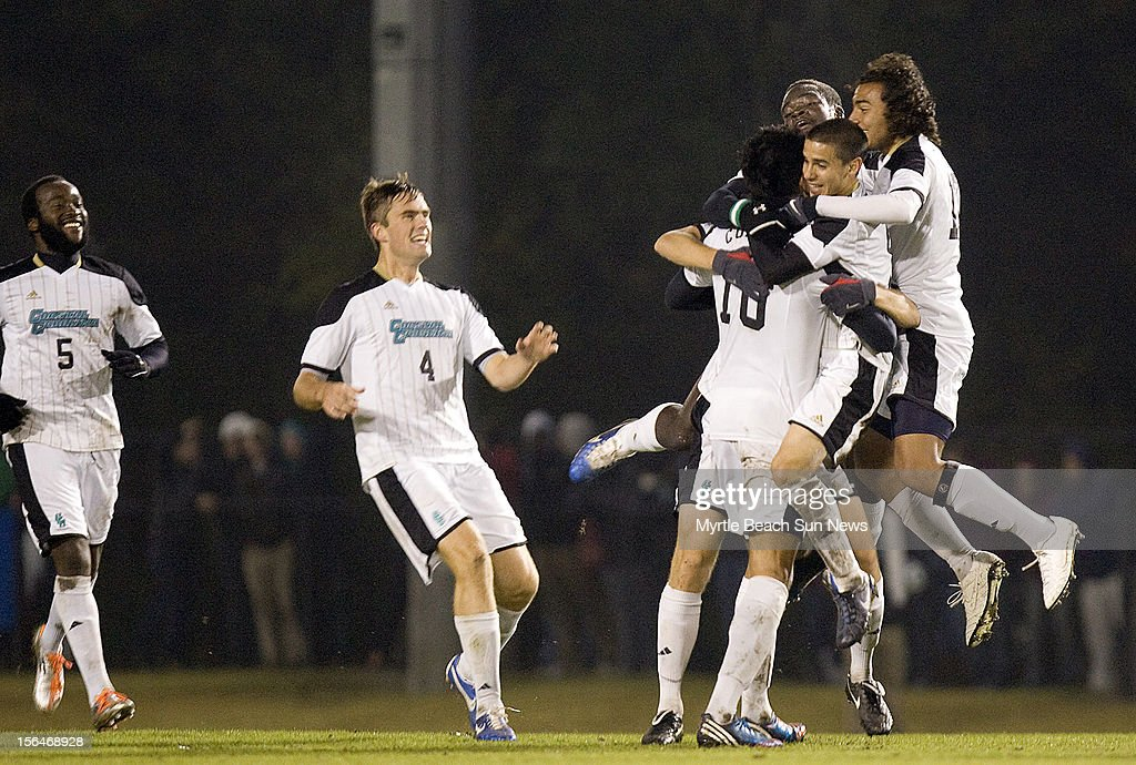 Coastal Carolina University's Pedro Ribeiro (10) celebrates with teammates after he scored against Elon in the first round of the NCAA Men's Soccer Championship in Conway, South Carolina, Thursday, November 15, 2012. Coastal defeated Elon, 3-0.