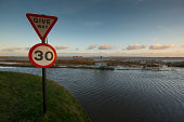 Coastal flood water and road signs, Norfolk UK