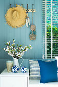 Coastal blue modern cushion and flower vase in modern living room