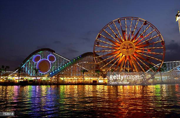 Coastal midwaytype rides including the California Sreamin'' roller coaster with the head of Mickey Mouse on it and the Sun Wheel ride shine during...