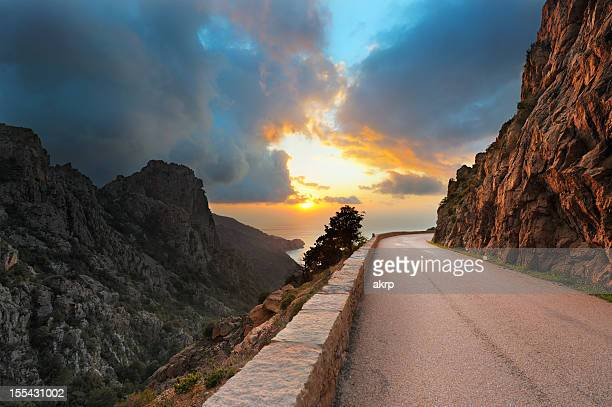 Coastal Road on the Island of Corsica at Sunset
