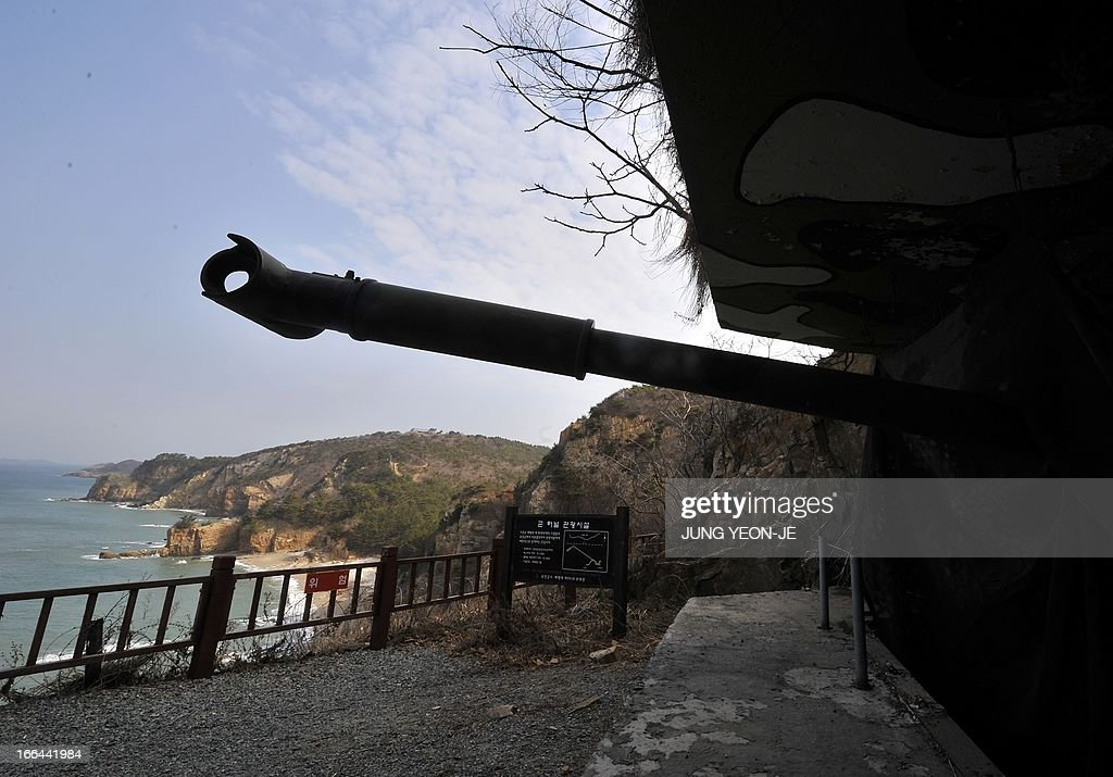 A coastcannon remodeled for tourists is set in a position at the South Koreacontrolled island of Yeonpyeong near the disputed waters of the Yellow...