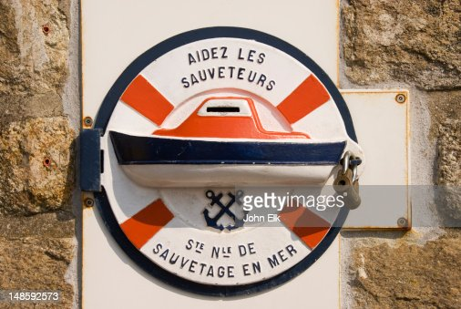 Coastguard donation box at Cap Frehel lighthouse. : Stock Photo