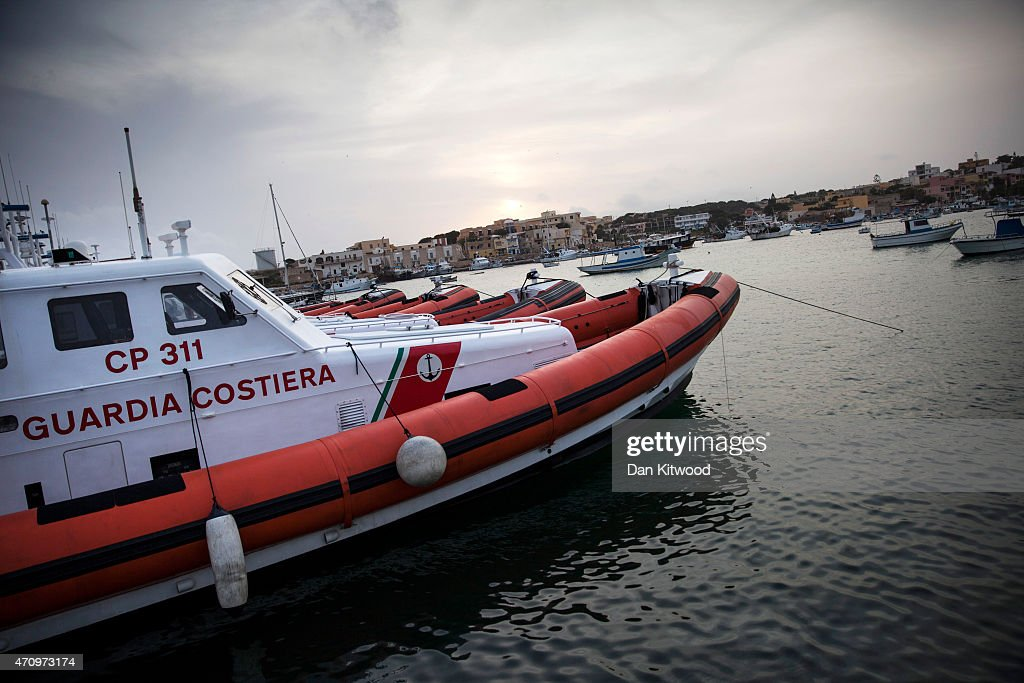 Coastguard vessels float in the harbour on April 24 2015 in Lampedusa Italy Migrants continue to arrive in Lampedusa from North Africa Hundreds of...