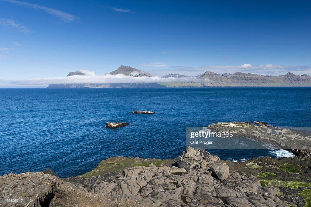 Coastline, Kalsoy island at back, Djupini, Gjogv, Eysturoy, Faroe Islands, Denmark