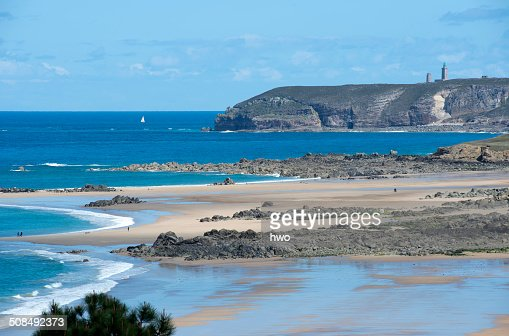 Coastline with a sandy beach and rocks at low tide, Cap Frehel at back, Frehel, Department Cotes d'Armor, Brittany, France, Europe