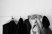 Coats and hangers on jackets in black and white