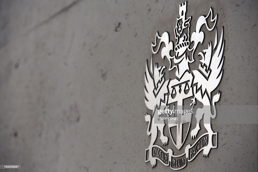 A Coat of Arms sits outside the main entrance of the London Stock Exchange Group Plc's (LSE) headquarters in London, U.K., on Monday, March 11, 2013. European stocks fell from a 4 1/2-year high as Fitch Ratings downgraded Italy and China's retail sales and industrial output missed forecasts. Photographer: Jason Alden/Bloomberg via Getty Images