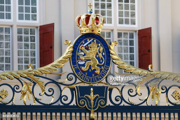 Coat of arms with a crown is pictured on the front gate of Palace Noordeinde ahead of Prinsjesdag on September 19 2017 in The Hague Netherlands The...