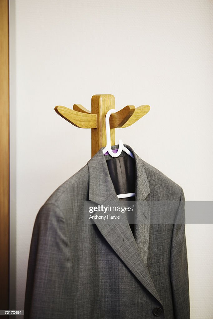 Suit Jacket Hanging On Office Coat Rack Stock Photo Getty Images