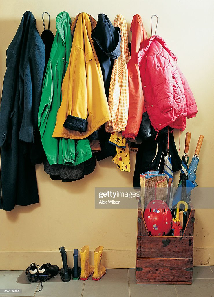 Coat Rack with Shoes and Umbrellas Underneath : Stock Photo
