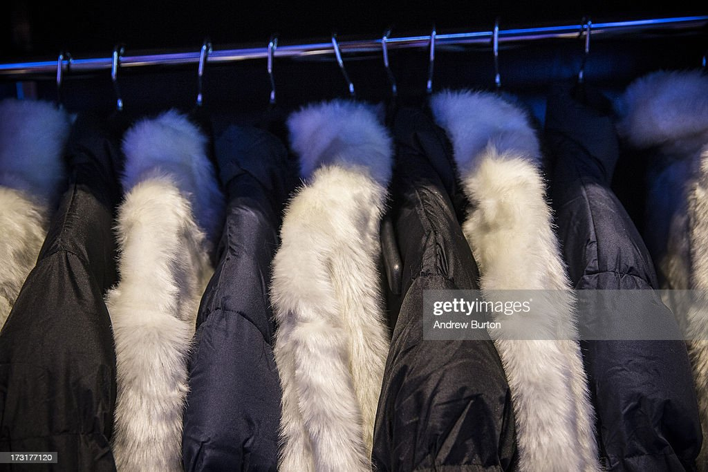 Coats hang on a rack at Minus5 Ice Bar during a media preview on July 9, 2013 in New York City. The bar, which opened yesterday, is built from 90 tons of ice, kept at 23 degrees Fahrenheit, or minus 5 degrees Celsius, and can hold 55 people.