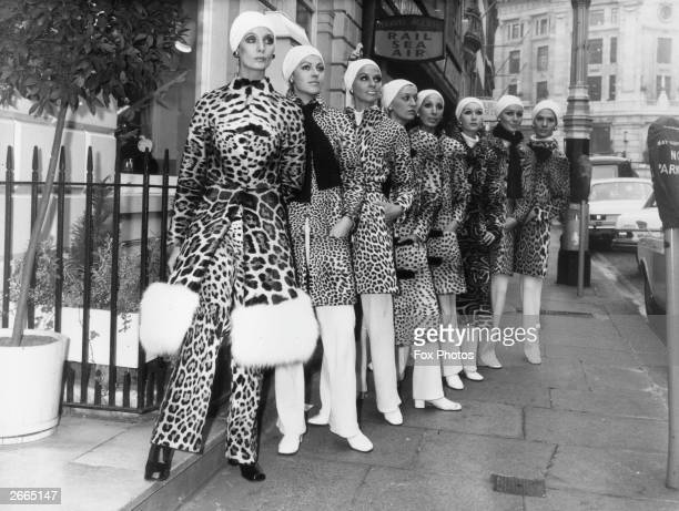 Coats made from the fur of various felines being modelled on a London street