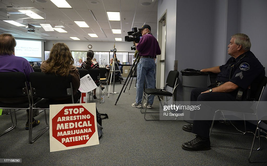 Some marijuana patients on Colorado's registry are protesting a Board of Health meeting, August 21, 2013. The patients are calling for the state to shut down its list of about 107,000 people who have cards that allow them to buy marijuana at dispensaries.