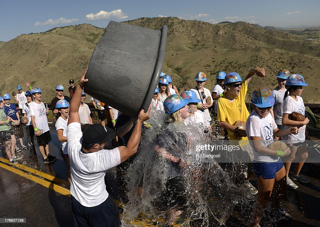 Upper class men spray water on freshmen at Colorado School of Mines during the M Climb one of the schools oldest traditions dating back to 1908...