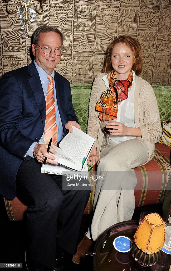Co-Author and Executive Chairman of Google Eric Schmidt (L) and Lily Cole attend the launch of 'The New Digital Age: Reshaping The Future Of People, Nations and Business' by Eric Schmidt and Jared Cohen, hosted by Jamie Reuben, at Loulou's on May 28, 2013 in London, England.