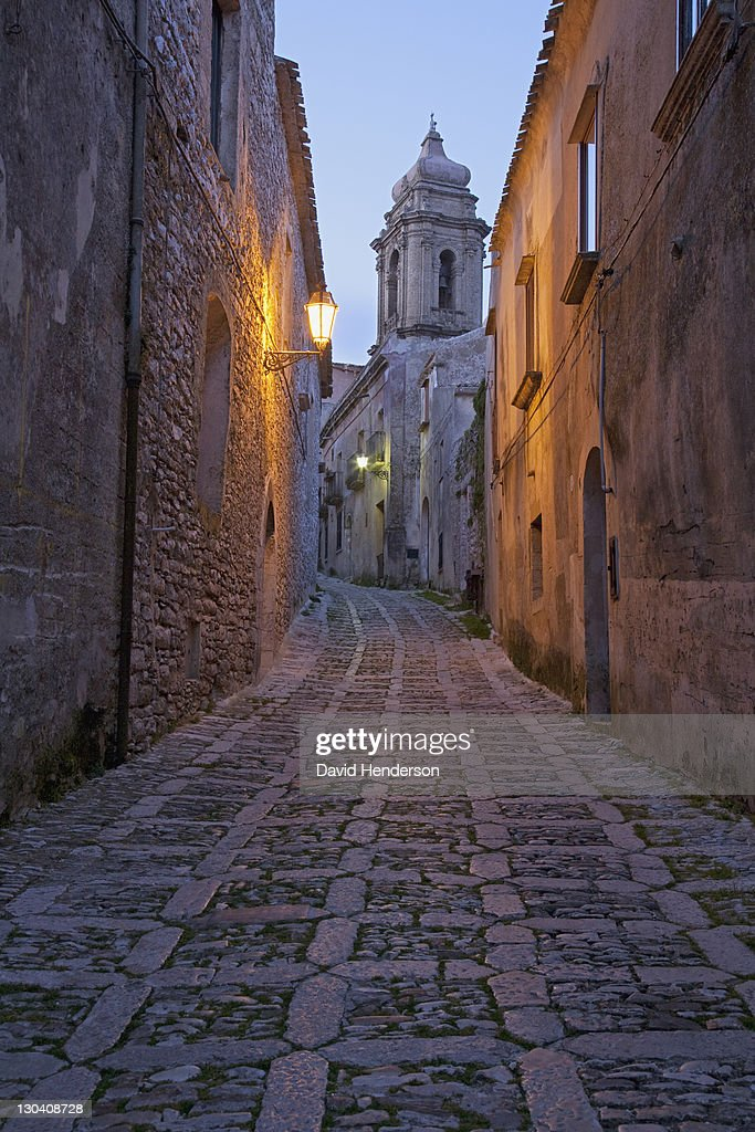Cobbled alleyway of old city lit up at night : Stock Photo