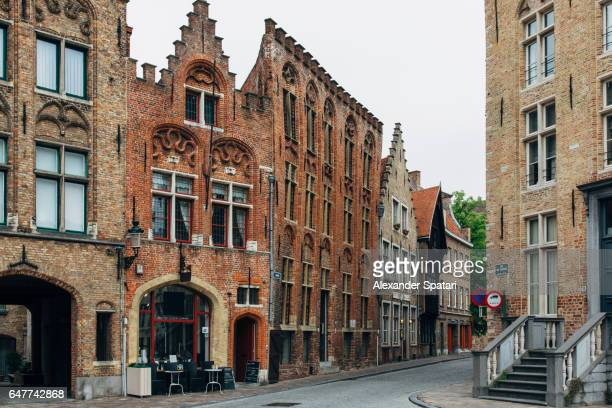 Cobbled street in the old town of Bruges, Flanders, Belgium