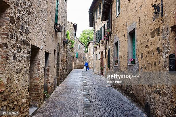 A cobblestone street in historic Montalcino Italy