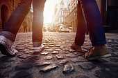tourist couple walking on cobblestone street vacation in europe on holiday break