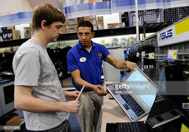 DENVER COBest Buy sales associate Ivan Patino right shows customer Andrew Tracy left a laptop computer at Best Buy on S Colorado Blvd and Mexico Ave...