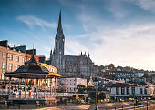A view of St Colman's Cathedral from the promenade in the picturesque town of Cobh, Co. Cork, Ireland.