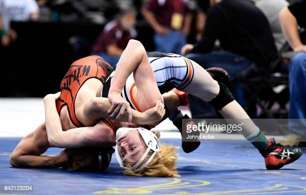 Cobie Back of Del Norte bottom gets tied up by Brendyn Nordyke of Holly during their Class 2A 120 pends match at the Colorado high school state...