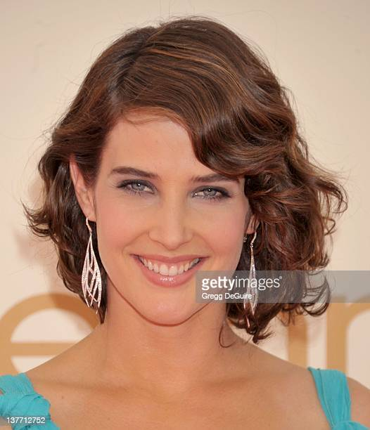 Cobie Smulders and Mario Lopez arrive at the Academy of Television Arts Sciences 63rd Primetime Emmy Awards at Nokia Theatre LA Live on September 18...