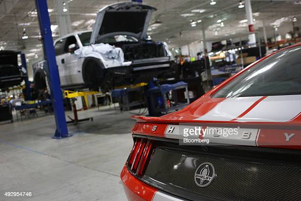 A Cobra Mustang right and Ford Motor Co Raptor pickup truck receive upgrades at the Shelby American Inc world headquarters in Las Vegas Nevada US on...