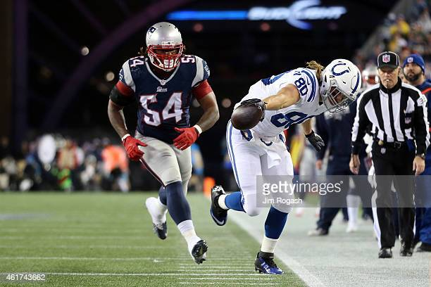 Coby Fleener of the Indianapolis Colts reaches with the ball in the first half against Dont'a Hightower of the New England Patriots of the 2015 AFC...