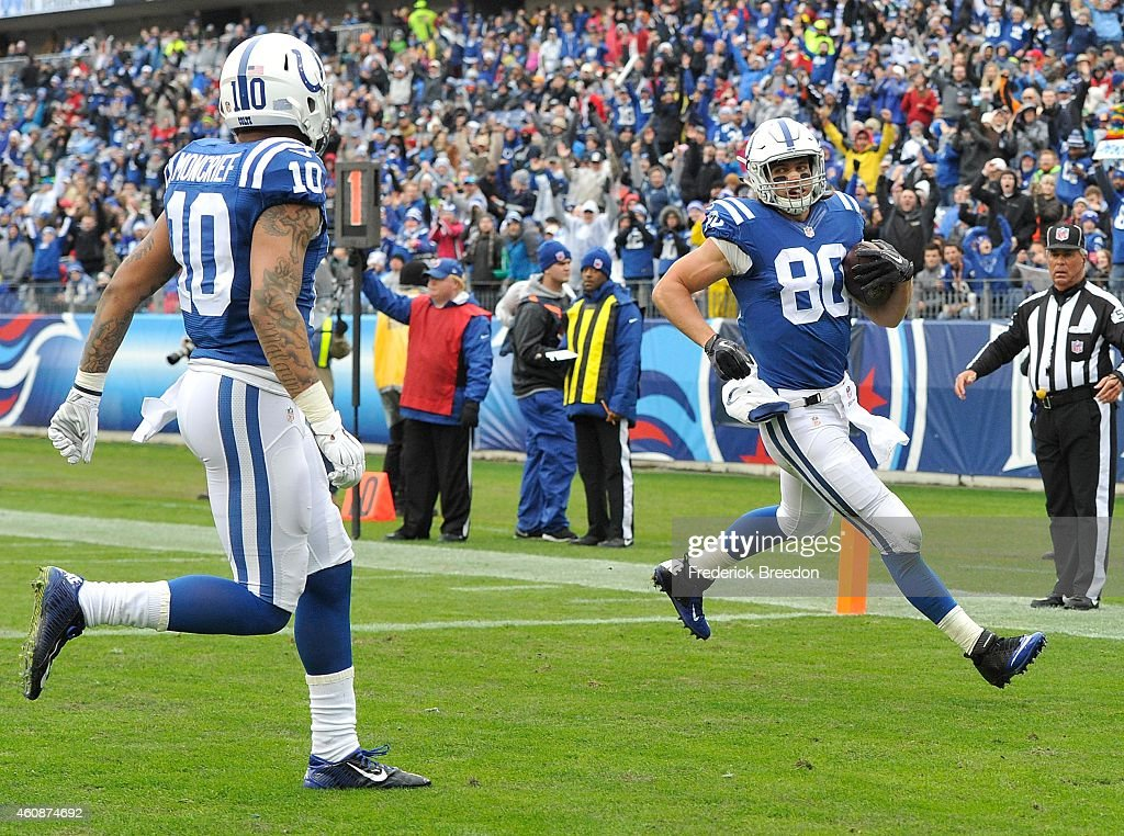 Coby Fleener #80 of the Indianapolis Colts scores a touchdown against the Tennessee Titans during the first quarter of a game at LP Field on December 28, 2014 in Nashville, Tennessee.
