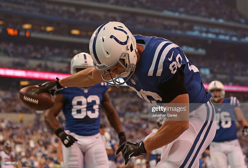Coby Fleener #80 of the Indianapolis Colts spikes the ball after scoring against the Houston Texans at Lucas Oil Stadium on December 30, 2012 in Indianapolis, Indiana. The Colts defeated the Texans 28-16.