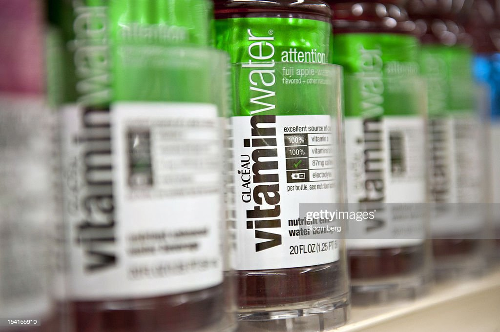 Coca-Cola Co. Glaceau vitamin water brand bottled water sits on display in a supermarket in Princeton, Illinois, U.S., on Friday, Oct. 12, 2012. Coca-Cola Co. is scheduled to release earnings data on Oct. 16. Photographer: Daniel Acker/Bloomberg via Getty Images