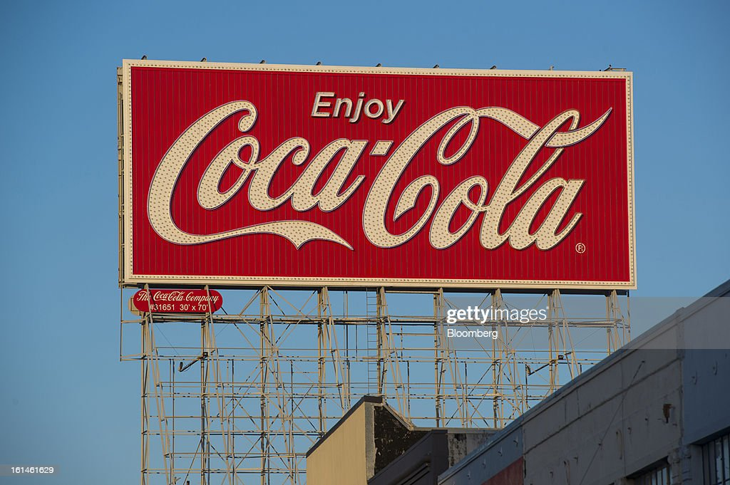 Coca-Cola Co signage is displayed on top of a building on Bryant Street in San Francisco, California, U.S., on Wednesday, Feb. 6, 2013. The Coca-Cola Co. is scheduled to release earnings data on on Feb. 12. Photographer: David Paul Morris/Bloomberg via Getty Images