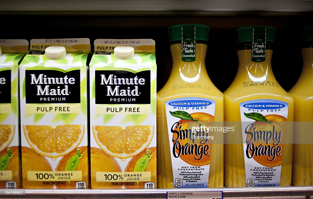 Coca-Cola Co.'s Minute Maid and Simply Orange brand orange juices sit on display in a supermarket in Princeton, Illinois, U.S., on Friday, Oct. 12, 2012. Coca-Cola Co. is scheduled to release earnings data on Oct. 16. Photographer: Daniel Acker/Bloomberg via Getty Images