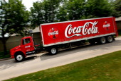 CocaCola delivery truck passes the CocaCola Bottling Company of North Texas plant on April 25 2011 in Fort Worth Texas CocaCola Company the world's...