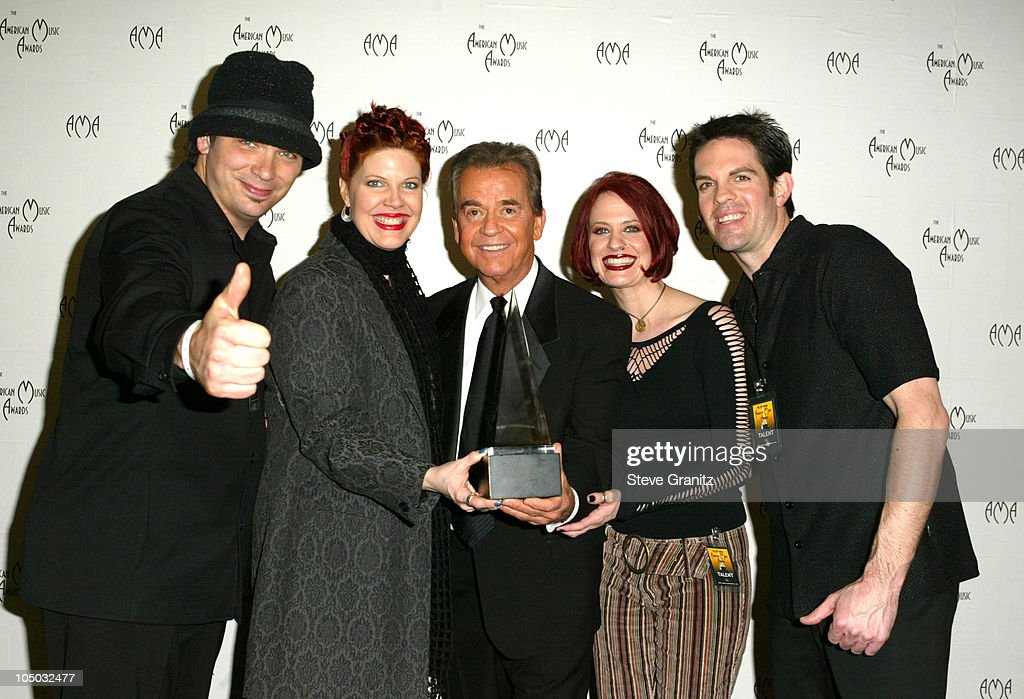 Coca-Cola winner Moe Loughran and <a gi-track='captionPersonalityLinkClicked' href=/galleries/search?phrase=Dick+Clark&family=editorial&specificpeople=213041 ng-click='$event.stopPropagation()'>Dick Clark</a> during The 30th Annual American Music Awards - Press Room at Shrine Auditorium in Los Angeles, California, United States.