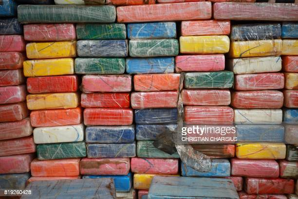 TOPSHOT Cocaine packets are pictured during a press conference on July 20 2017 in Hamburg 38 tons of cocaine with a value of 800 million euro is the...
