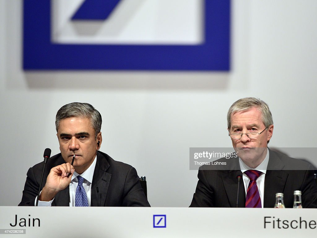 Co-CEO of Deutsche Bank AG Anshu (L) and <a gi-track='captionPersonalityLinkClicked' href=/galleries/search?phrase=Juergen+Fitschen&family=editorial&specificpeople=3093173 ng-click='$event.stopPropagation()'>Juergen Fitschen</a> (R), co-CEO of the Deutsche Bank speak at Deutsche Bank's annual shareholder meeting on May 21, 2015 in Frankfurt am Main, Germany. Deutsche Bank's shareholders are gathering for their annual meeting with strong concerns.