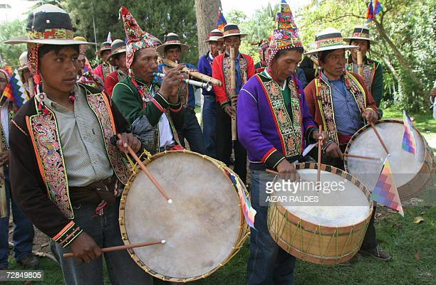 A group of Quechua indigenous peasants play traditional musical instruments 07 December 2006 in Cochabamba as part of an alternative event to the...