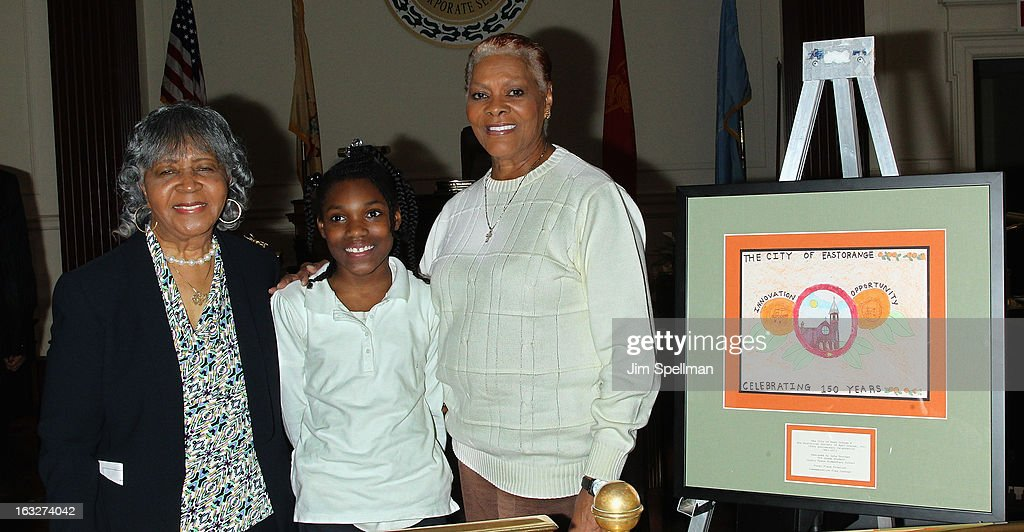 Co-Chair, 150th Anniversary Celebration Committee Goldie T. Burbage, first place finalist commemorative flag contest winner Isha Trotman and actress <a gi-track='captionPersonalityLinkClicked' href=/galleries/search?phrase=Dionne+Warwick&family=editorial&specificpeople=213111 ng-click='$event.stopPropagation()'>Dionne Warwick</a> attend the 150th Anniversary of East Orange, New Jersey at Council Chambers on March 6, 2013 in East Orange, New Jersey.