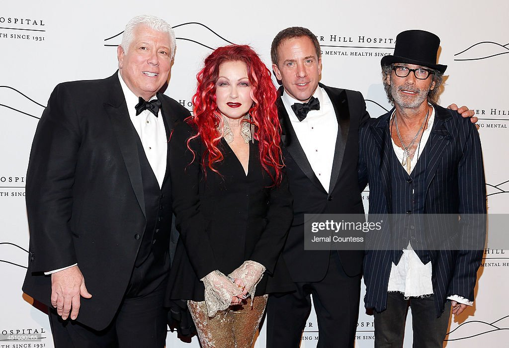 Co-chair Dennis Basso, singer/musician <a gi-track='captionPersonalityLinkClicked' href=/galleries/search?phrase=Cyndi+Lauper&family=editorial&specificpeople=171290 ng-click='$event.stopPropagation()'>Cyndi Lauper</a>, co-chair Michael Cominotto and Jonny Podell attend the 2013 Silver Hospital gala at Cipriani 42nd Street on November 20, 2013 in New York City.