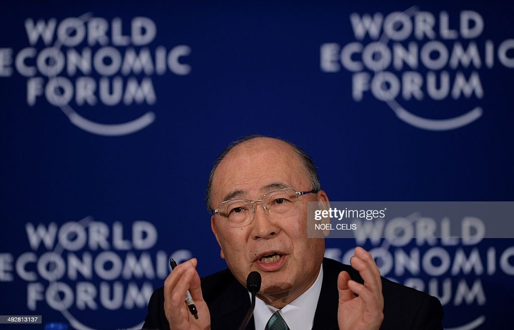 Co-Chair of the World Economic Forum on East Asia 2014 and Chairman of the Board of Toshiba Corporation, Japan, <a gi-track='captionPersonalityLinkClicked' href=/galleries/search?phrase=Atsutoshi+Nishida&family=editorial&specificpeople=640193 ng-click='$event.stopPropagation()'>Atsutoshi Nishida</a>, gestures at a press conference during the World Economic Forum in Manila on May 22, 2014. The forum, focusing on the fastest-growing region of the world, needs to look at ways to make growth more equitable and sustainable to bring more people out of poverty while also finding ways to minimise environmental damage brought on by the group.