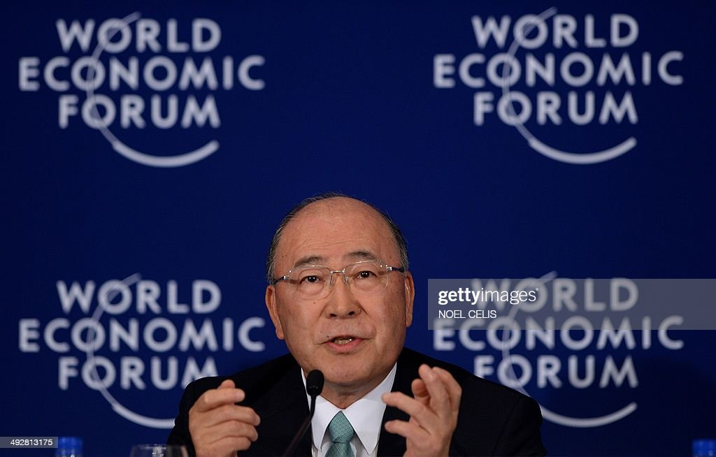 Co-Chair of the World Economic Forum on East Asia 2014 and Chairman of the Board Toshiba Corporation, Japan, <a gi-track='captionPersonalityLinkClicked' href=/galleries/search?phrase=Atsutoshi+Nishida&family=editorial&specificpeople=640193 ng-click='$event.stopPropagation()'>Atsutoshi Nishida</a>, gestures at a press conference during the World Economic Forum in Manila on May 22, 2014. The forum, focusing on the fastest-growing region of the world, needs to look at ways to make growth more equitable and sustainable to bring more people out of poverty while also finding ways to minimise environmental damage brought on by the group.