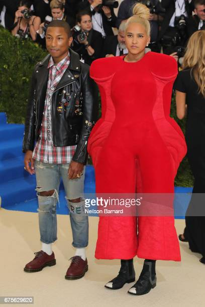 Cochair Pharrell Williams and Helen Lasichanh attend the 'Rei Kawakubo/Comme des Garcons Art Of The InBetween' Costume Institute Gala at Metropolitan...